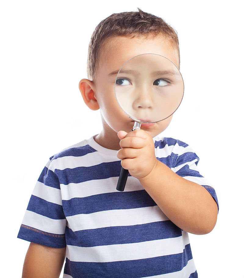 little boy with magnifying glass